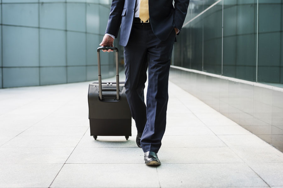 Businessman in suit with suitcase