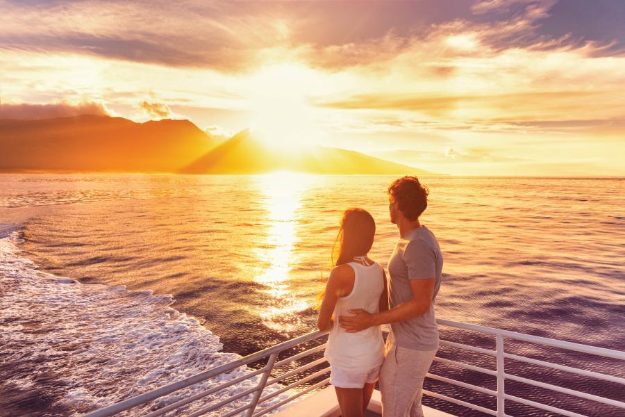 couple watching sunset on a cruise